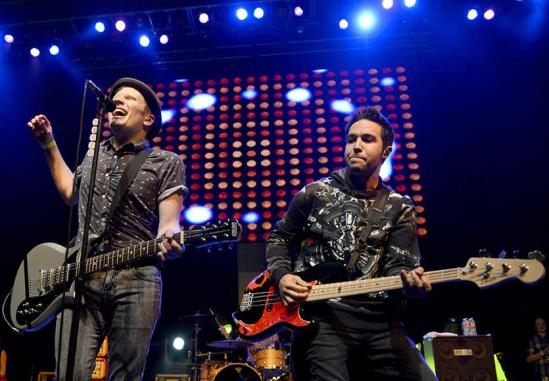 Patrick Stump, left, and Pete Wentz command the stage during Fall Out Boy's special 1 a.m. set at Austin's Vice Bar during SXSW March 16, 2013. [Image from http://s3.amazonaws.com]